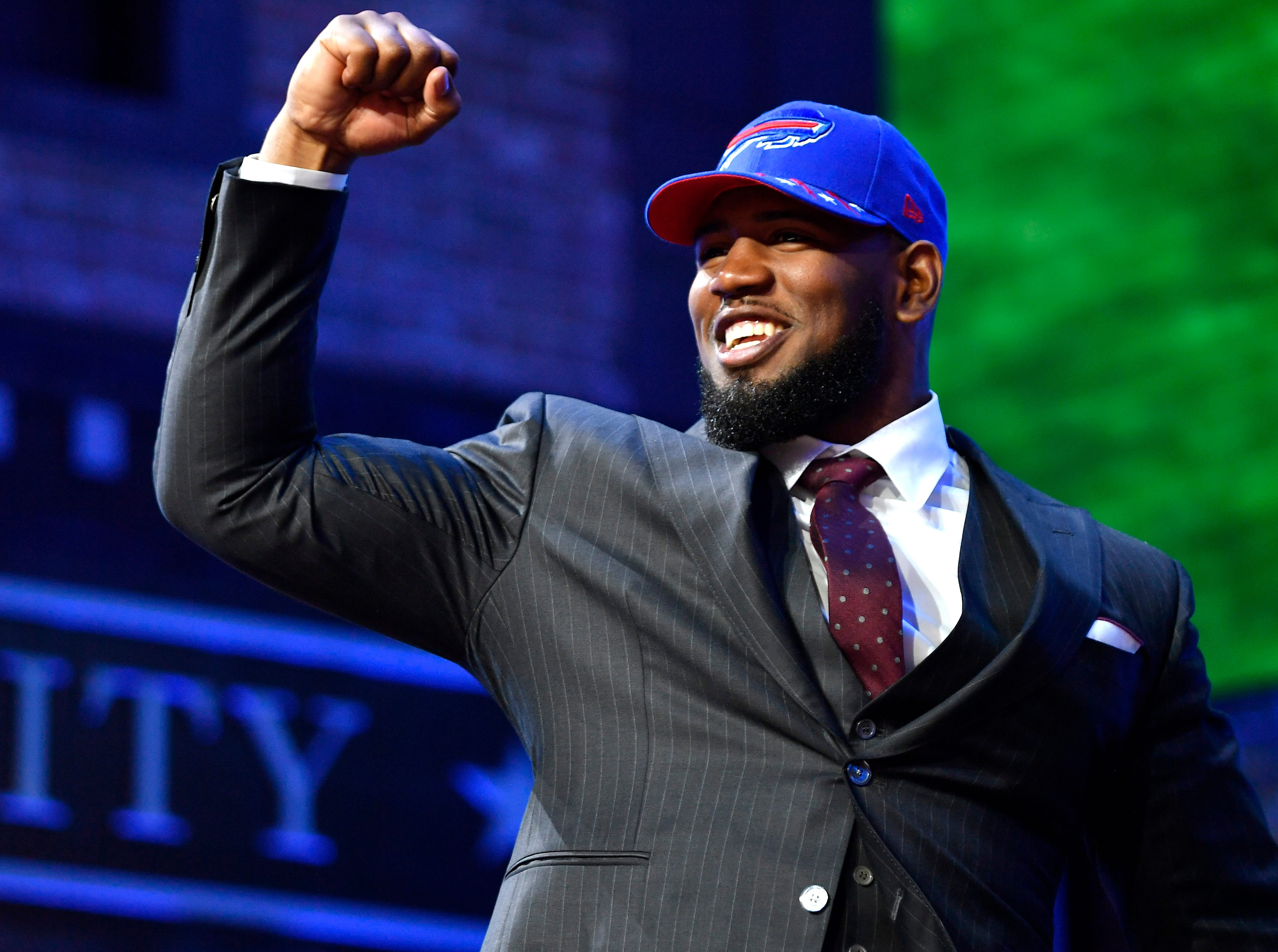Ed Oliver celebrates his pick by the Buffalo Bills during the first round of the NFL Draft Thursday, April 25, 2019, in Nashville, Tenn.