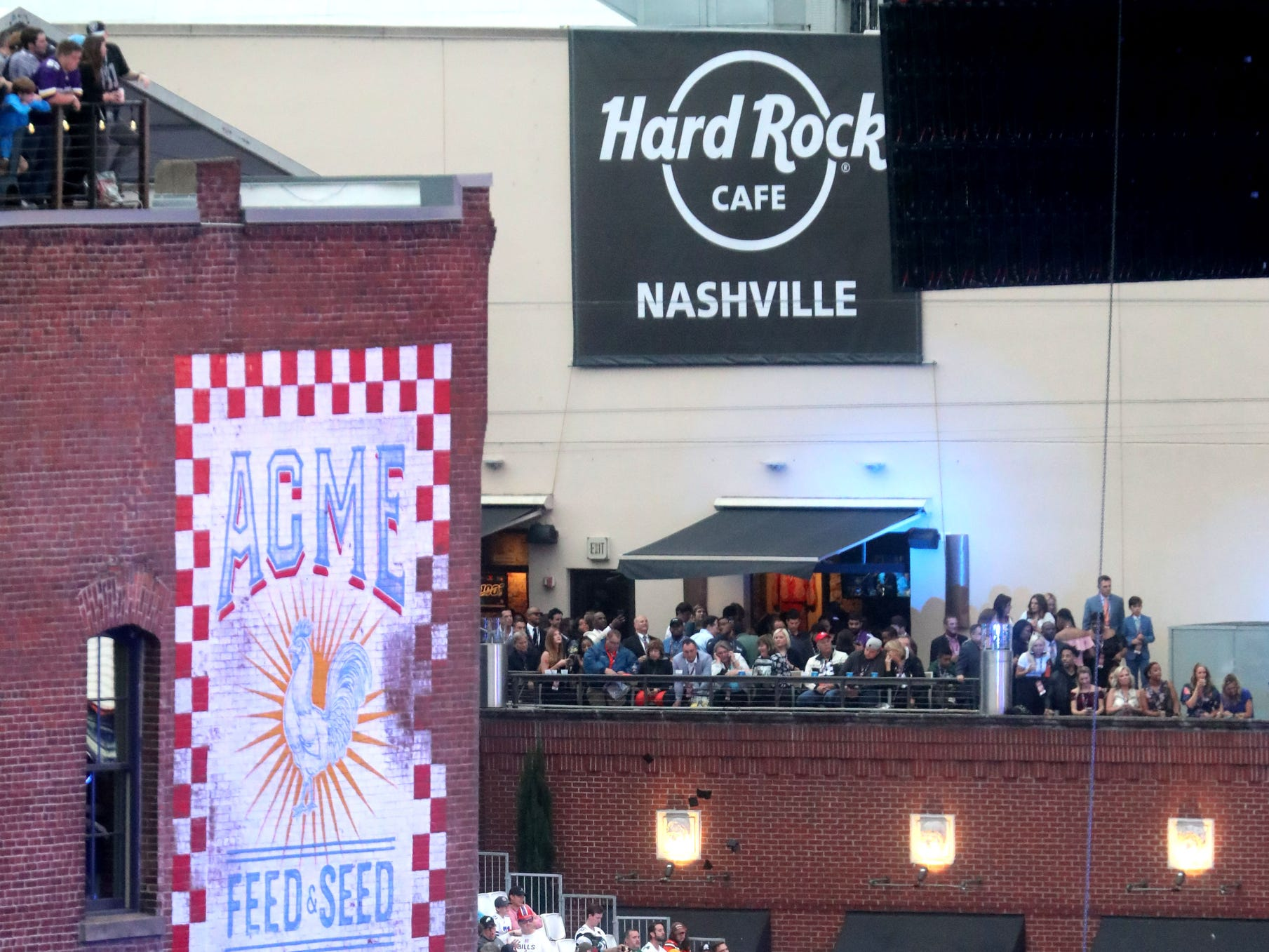 Fans hang out on rooftops and in front of the stage on Lower Broadway as the first round of the NFL Draft begins on Thursday, April 25, 2019, in Nashville, Tennessee.