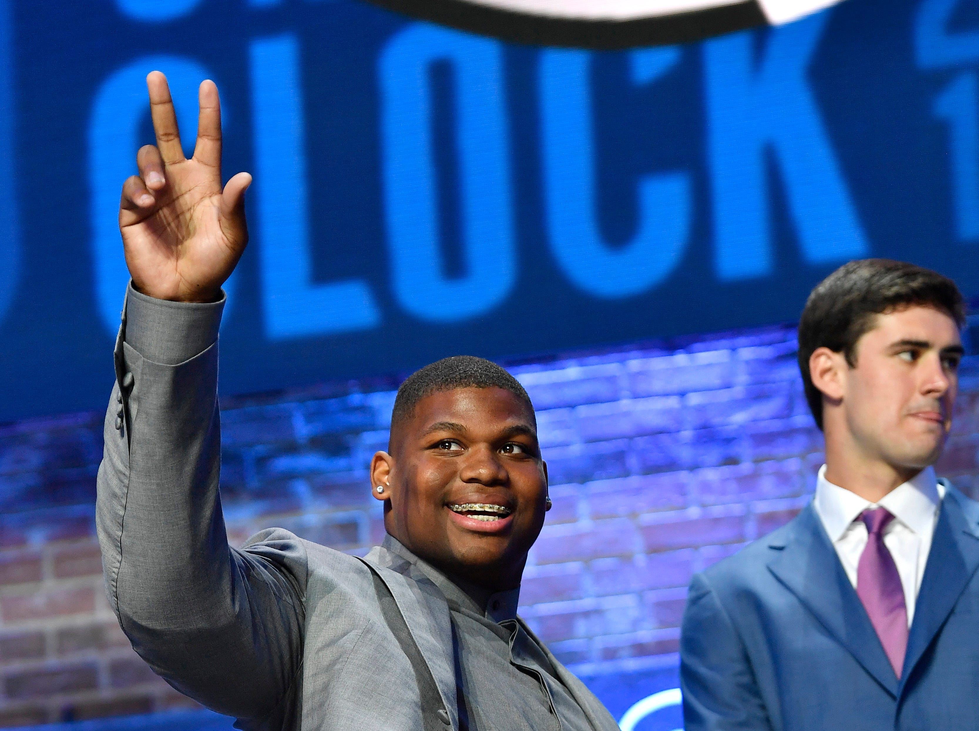Quinnen Williams of Alabama waves to the crowd as he comes on stage for the first round of the NFL Draft Thursday, April 25, 2019, in Nashville, Tenn.