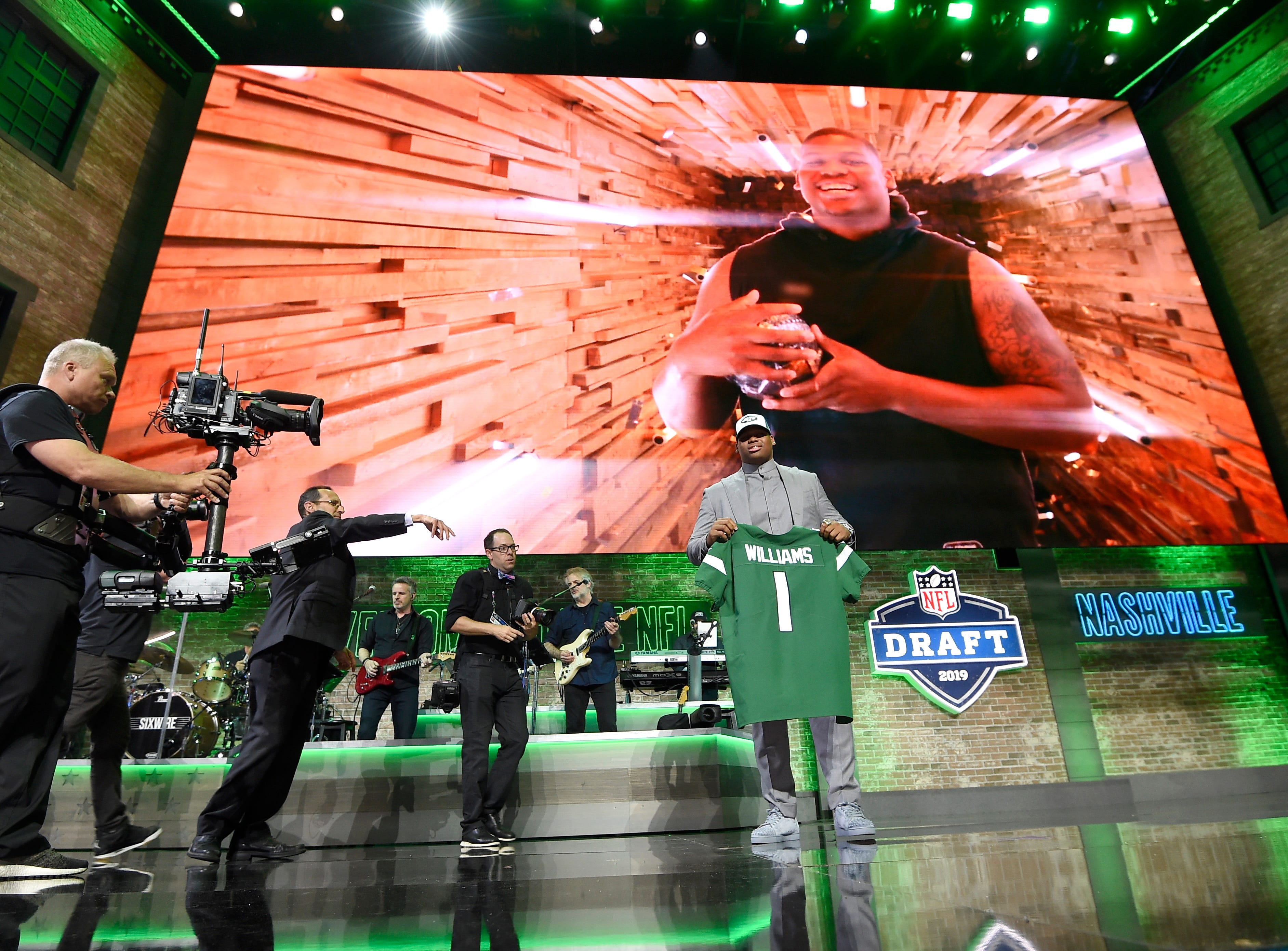 Quinnen WIlliams holds his new New York Jets jersey after being picked during the first round of the NFL Draft Thursday, April 25, 2019, in Nashville, Tenn.