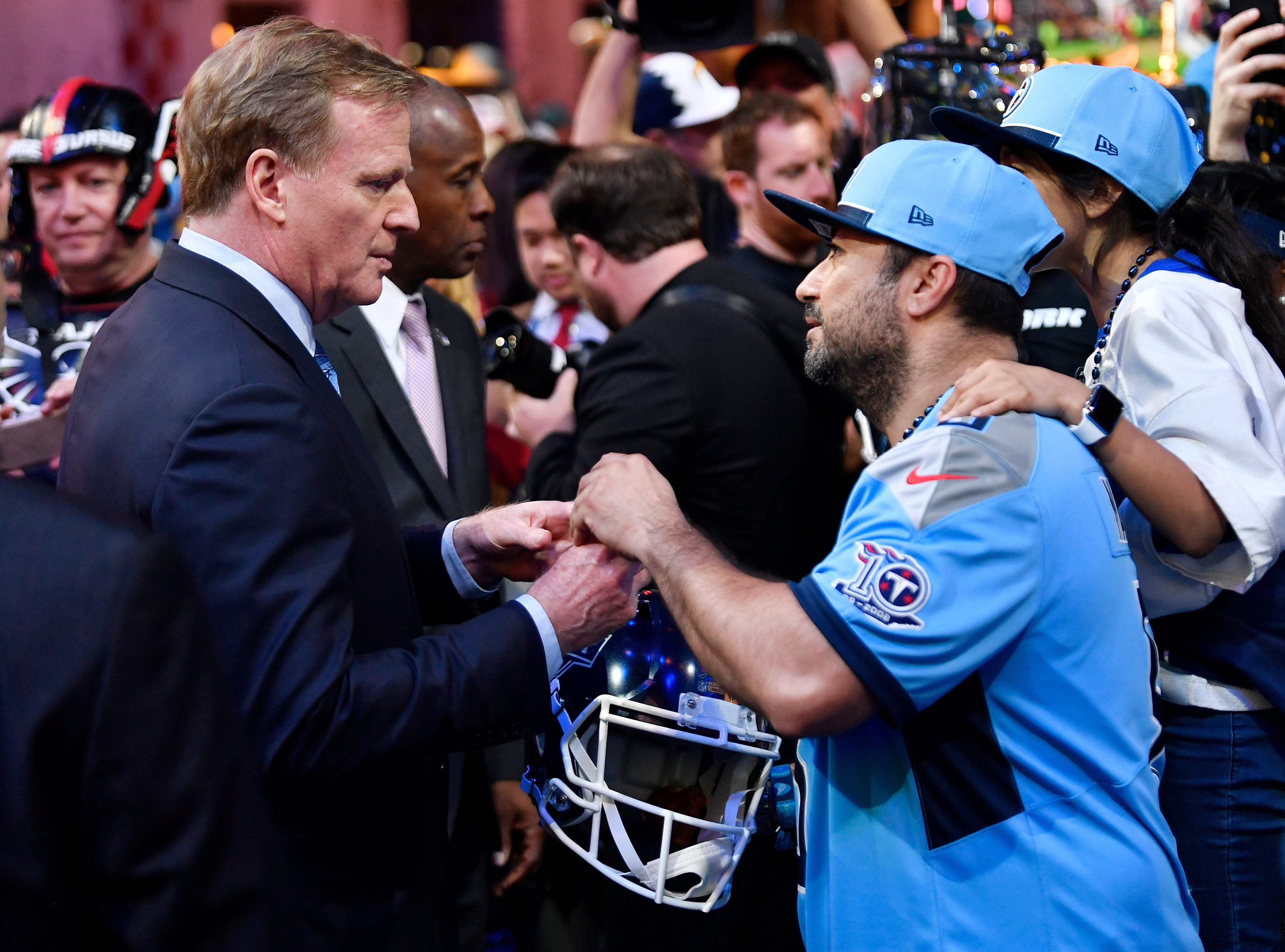 NFL Commissioner Roger Goodell signs an autograph for Titans fan Juan Delgado during the first round of the NFL Draft Thursday, April 25, 2019, in Nashville, Tenn.