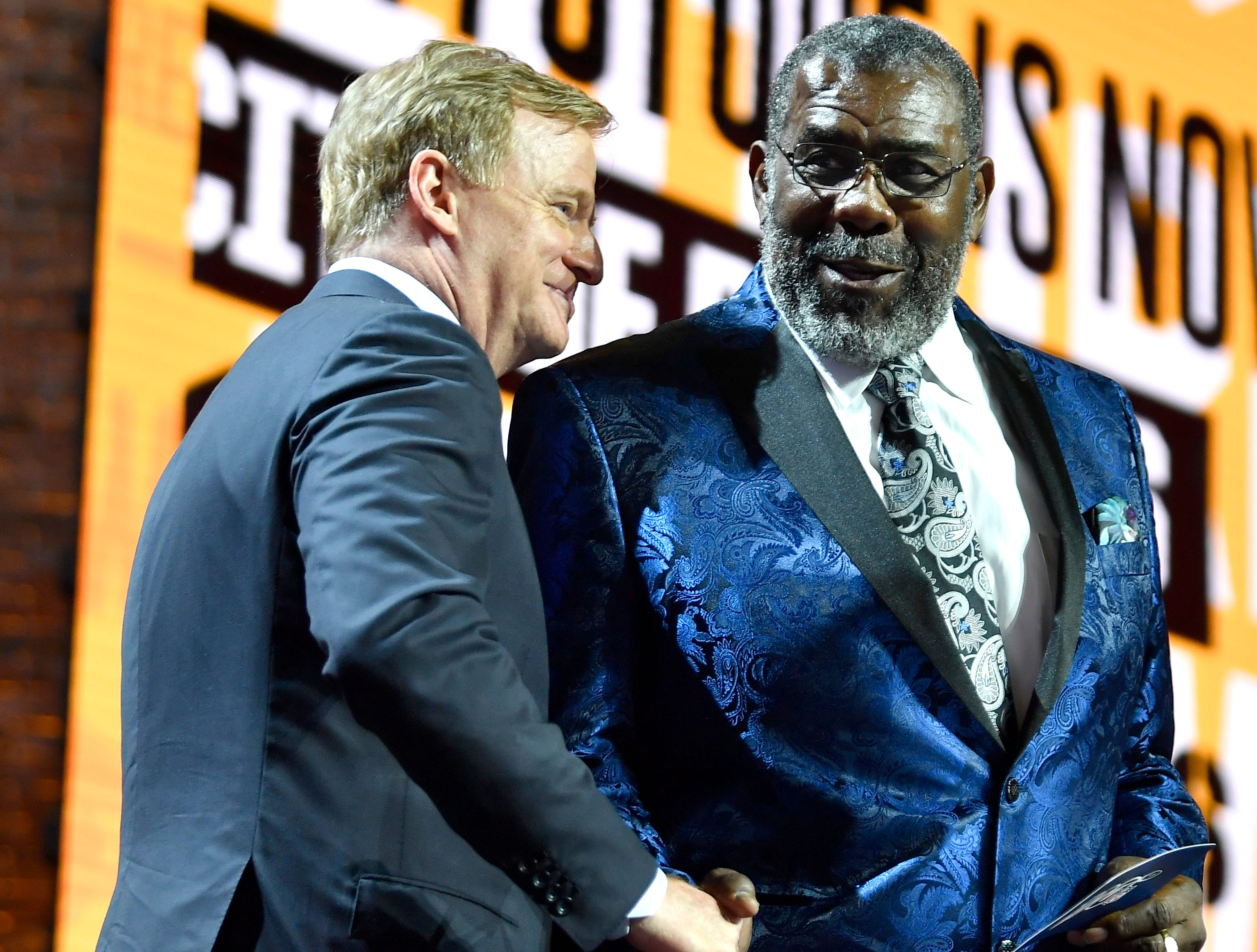 """NFL Commissioner Roger Goodell shakes hands with """"Mean"""" Joe Greene before he makes the Steelers' pick during the first round of the NFL Draft Thursday, April 25, 2019, in Nashville, Tenn."""