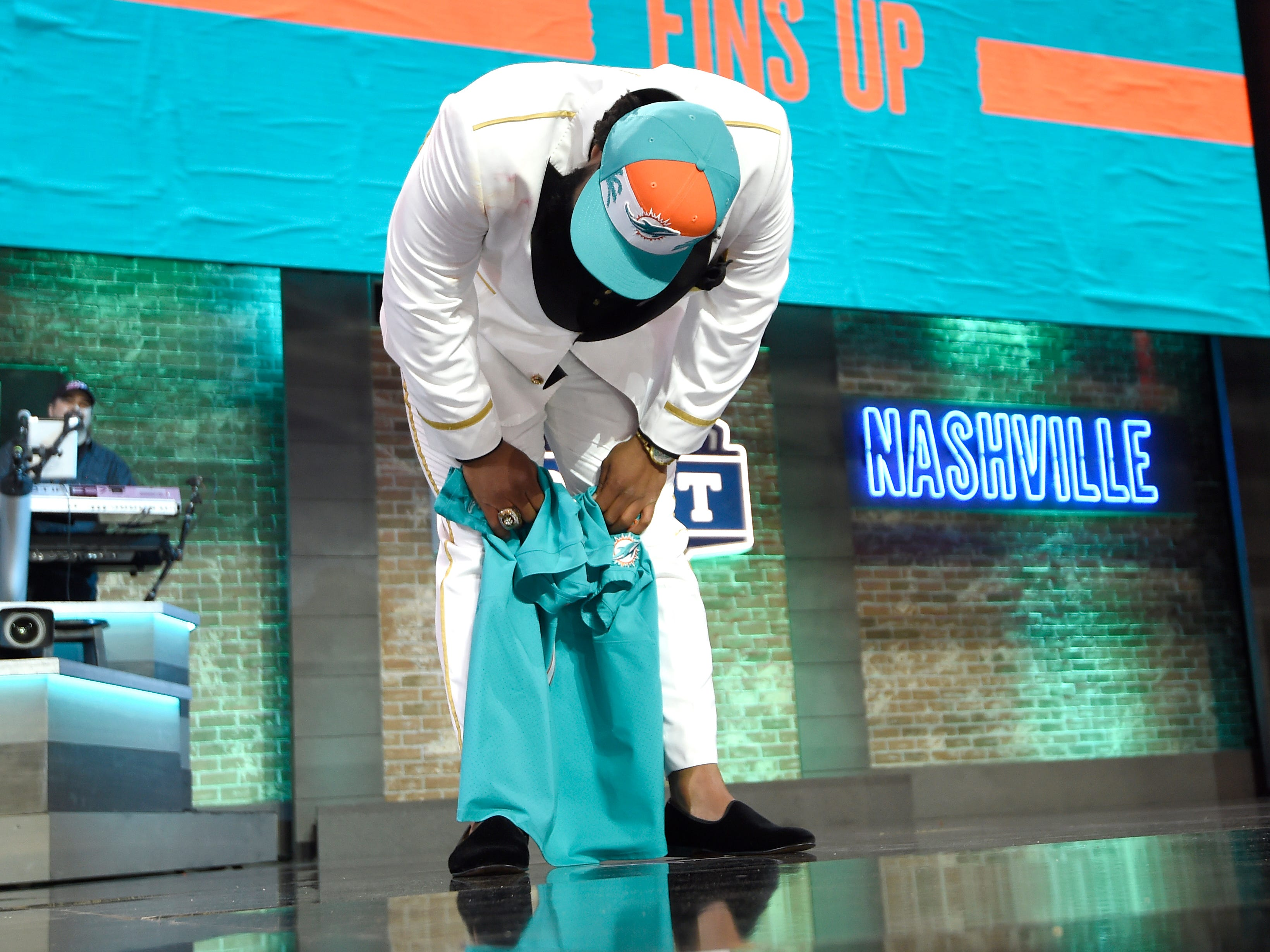 Christian Wilkins gets emotional after his his pick by the Miami Dolphins during the first round of the NFL Draft Thursday, April 25, 2019, in Nashville, Tenn.