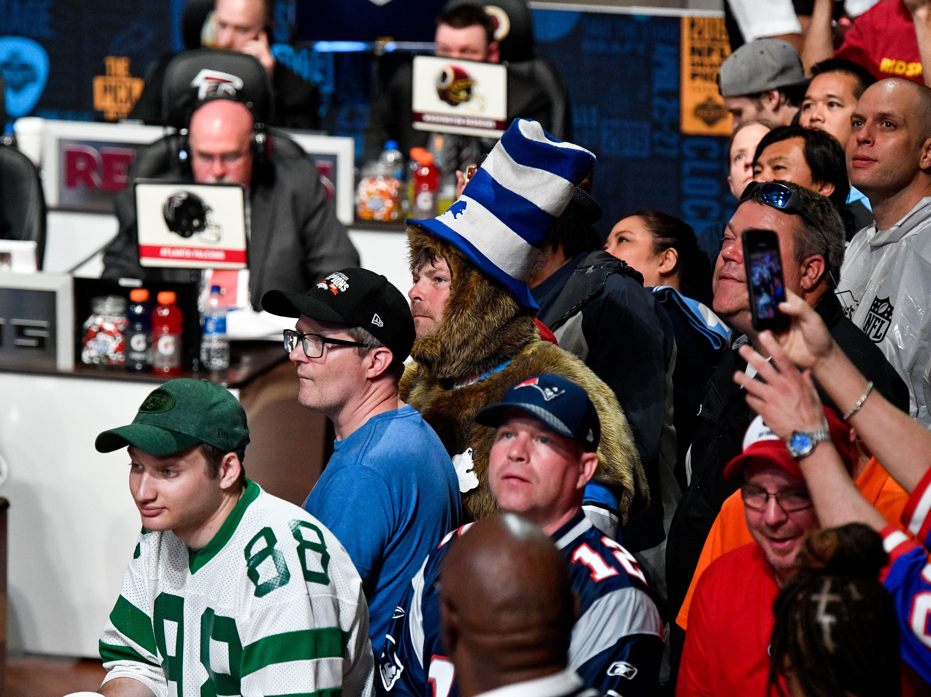 Fans watch as officials wait to make their pick in the first round of the NFL Draft at the Schermerhorn Symphony Center Thursday, April 25, 2019, in Nashville, Tenn.
