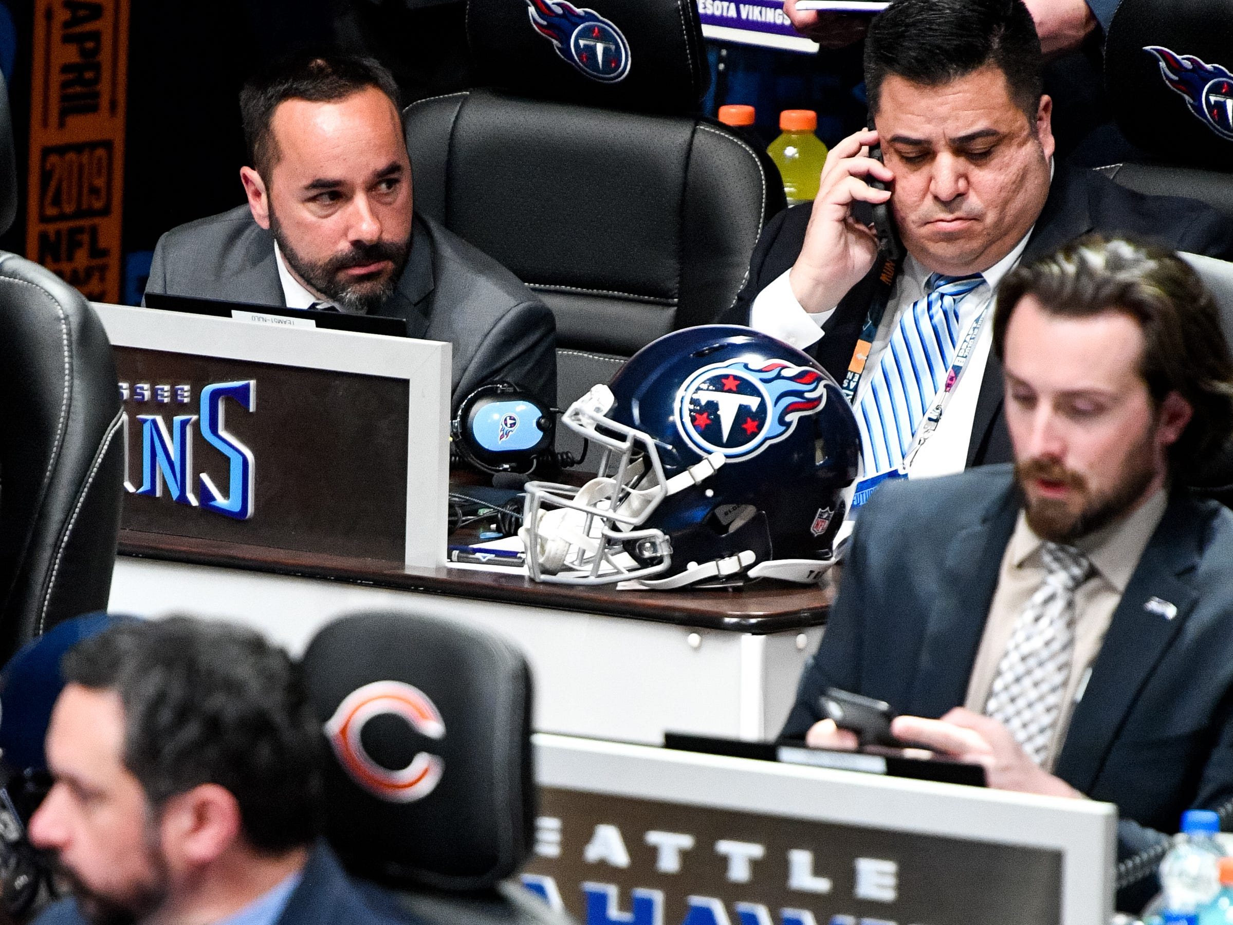 Titans personnel Joey Barranco, left, and Anthony Pastrana wait to make the team's pick in the first round of the NFL Draft at the Schermerhorn Symphony Center Thursday, April 25, 2019, in Nashville, Tenn.