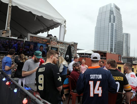 People enjoy the rooftop at Tin Roof during the ESPN watch party for the NFL draft Thursday, April 25, 2019.