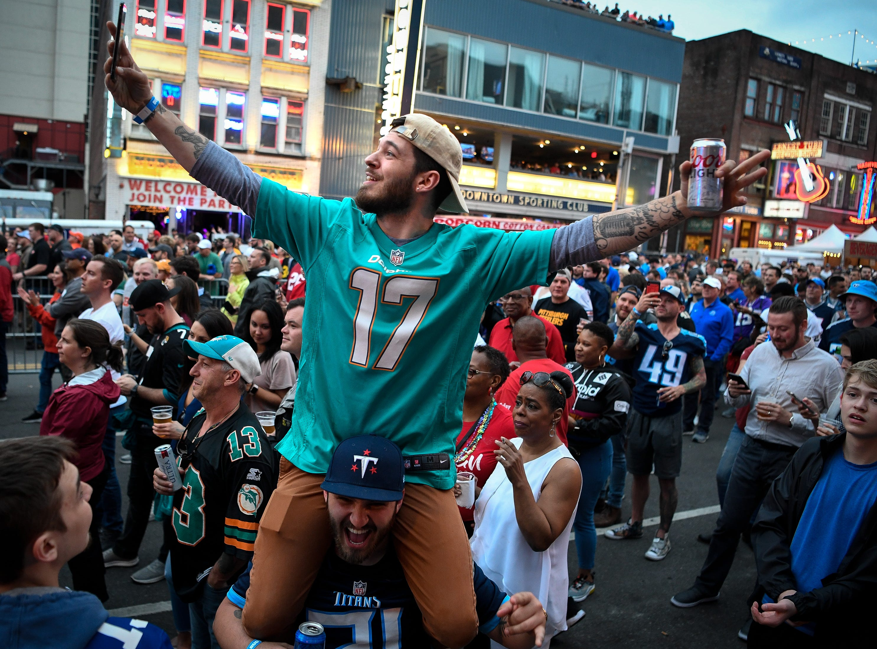 Michael Palella, of Albany, N.Y., cheers while on the shoulders of his brother, Brendan Palella, of Nashville, during the 2019 NFL Draft on Broadway in Nashville, Tenn., Thursday, April 25, 2019.
