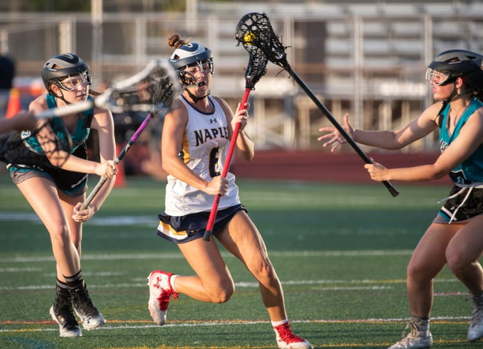 Karson Biggs of Naples tries to get past Gulf Coast defenders during the regional quarterfinal game at Naples High Thursday night, April 25, 2019.