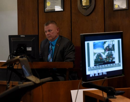 Newark Police Chief Barry Connell reviews stills of video footage from a Newark City Schools' bus while on trial trial for a traffic citation alleging he passed a stopped school bus in October. Connell was found guilty of passing a stopped school bus and visiting Judge Guy Reece II from Franklin County imposed a $100 fine in court costs.
