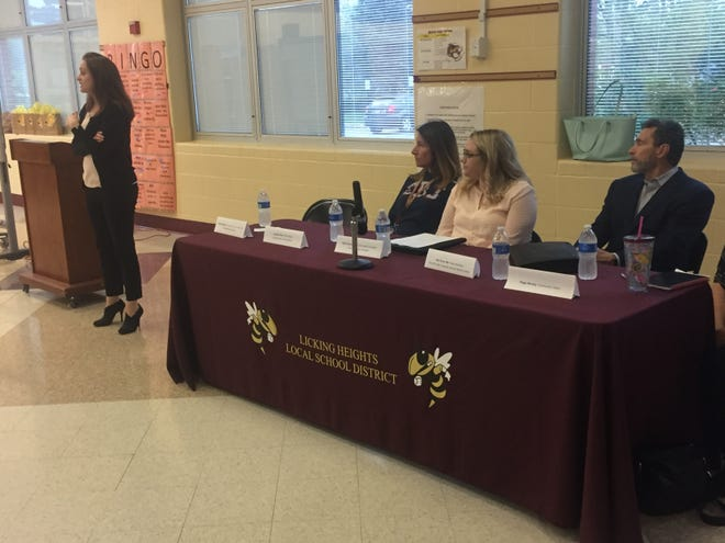 Panelists discuss the rising abuse of vaping or e-cigarette devices among middle and high school students April 25 at Central Middle School.