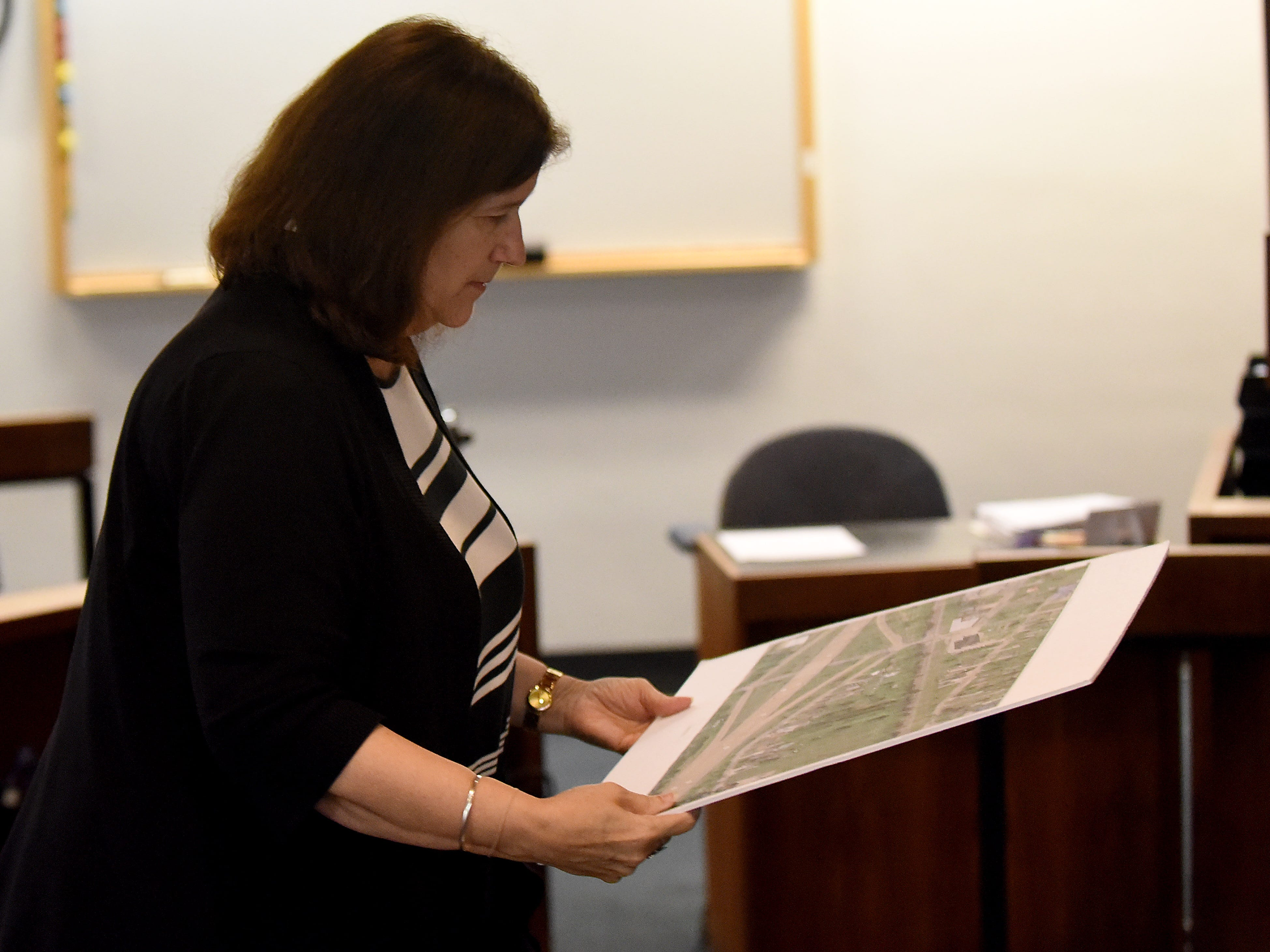 Defense attorney Kristin Burkett with a map of the area during Newark Police Chief Barry ConnellÕs trial for a traffic citation alleging he passed a stopped school bus in October.