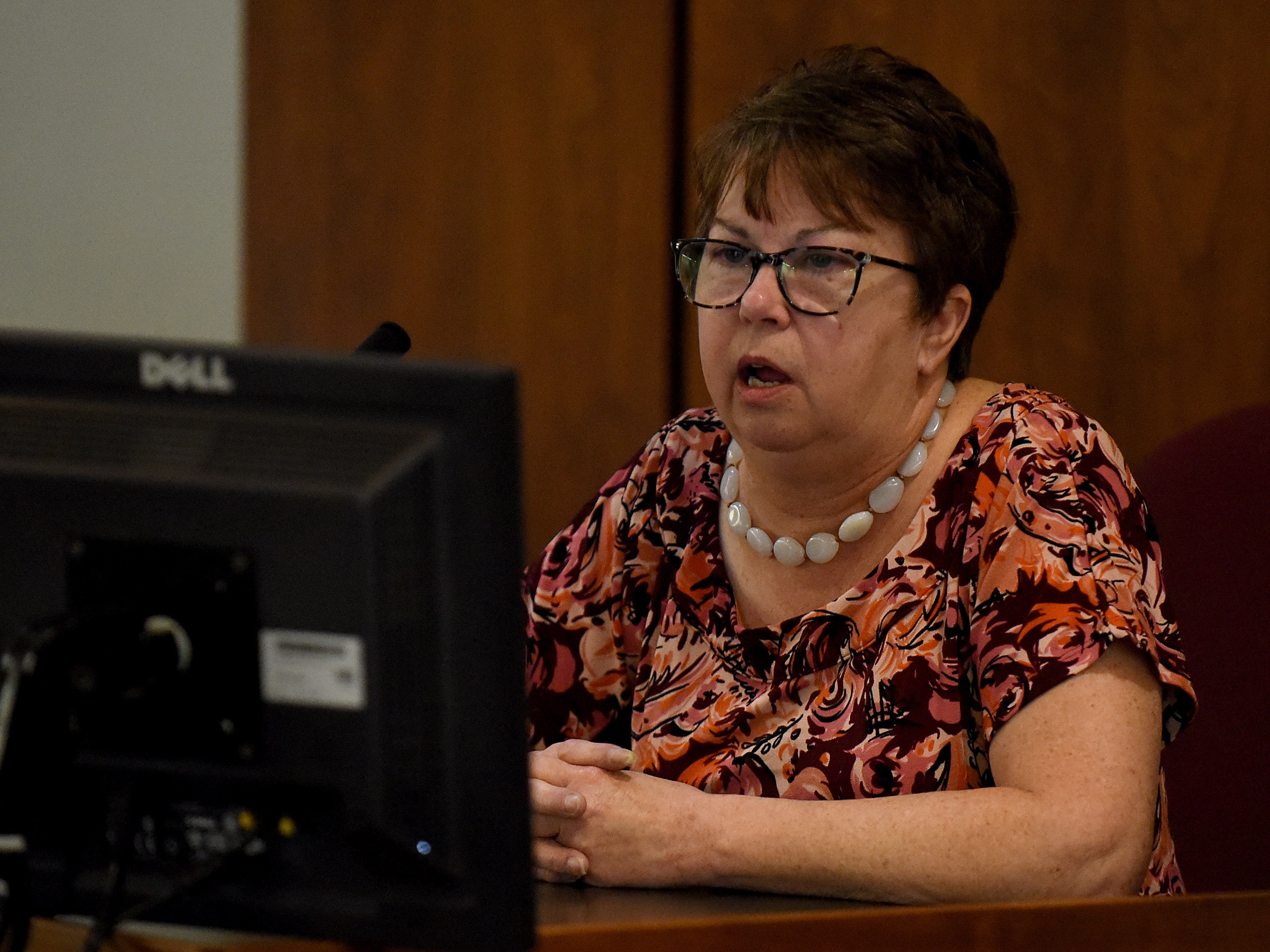 Newark City School bus driver Patty Hughes watches video footage from the bus while testifing during Newark Police Chief Barry Connell's trial for a traffic citation. Connell was found guilty of passing a stopped school bus and visiting Judge Guy Reece II from Franklin County imposed a $100 fine in court costs.