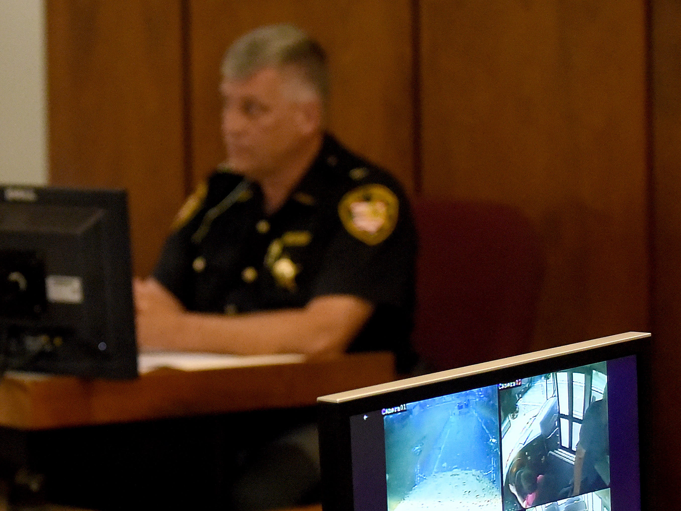Video footage from a Newark City Schools' is displayed as Licking County SheriffÕs Office Capt. Darl Evans testifies during Newark Police Chief Barry ConnellÕs trial for a traffic citation alleging he passed a stopped school bus in October.