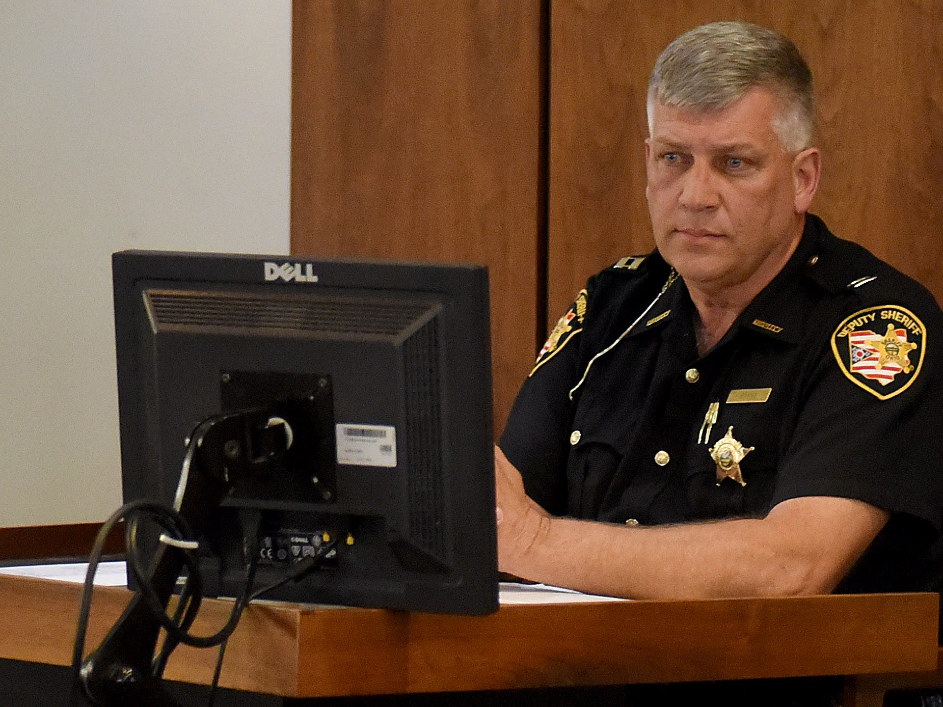 Licking County SheriffÕs Office Capt. Darl Evans testifies during Newark Police Chief Barry ConnellÕs trial for a traffic citation alleging he passed a stopped school bus in October.