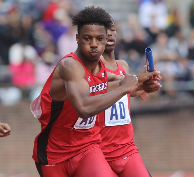 Sterling Pierce takes the baton from Chris Jenkins of Rutgers who started the college 4x400 relay for his team. Rutgers finished in 13th place overall and 4th in this heat with a time of 3:11.43.
