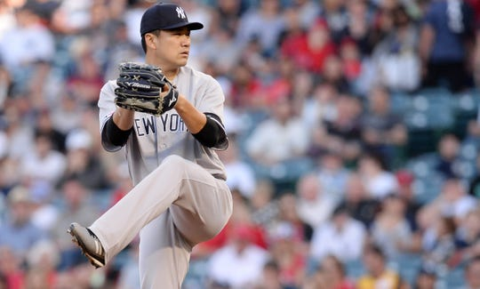 April 25, 2019; Anaheim, CA, USA; New York Yankees starting pitcher Masahiro Tanaka (19) throws against the Los Angeles Angels during the first inning at Angel Stadium of Anaheim.