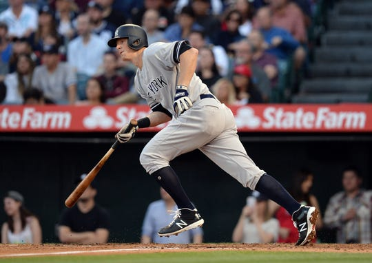 April 25, 2019; Anaheim, CA, USA; New York Yankees second baseman DJ LeMahieu (26) hits an RBI single against the Los Angeles Angels during the third inning at Angel Stadium of Anaheim.