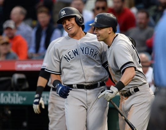 April 25, 2019; Anaheim, CA, USA; New York Yankees third baseman Gio Urshela (29) is greeted by left fielder Tyler Wade (14) after hitting a solo home run against the Los Angeles Angels during the fifth inning at Angel Stadium of Anaheim. Mandatory Credit: Gary A. Vasquez-USA TODAY Sports