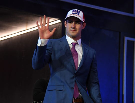 Apr 25, 2019; Nashville, TN, USA; Daniel Jones (Duke) is selected as the number six overall pick to the New York Giants in the first round of the 2019 NFL Draft in Downtown Nashville. Mandatory Credit: Christopher Hanewinckel-USA TODAY Sports
