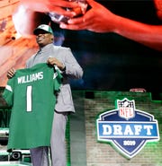 Alabama defensive tackle Quinnen Williams holds his new jersey after the New York Jets selected Williams in the first round at the NFL football draft, Thursday, April 25, 2019, in Nashville, Tenn. (AP Photo/Mark Humphrey)