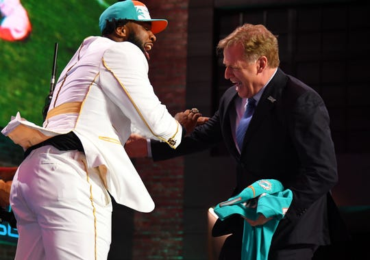 Christian Wilkins (Clemson) celebrates with NFL commissioner Roger Goodell after he was selected as the No. 13 overall pick to the Miami Dolphins  in the first round of the 2019 NFL Draft in Downtown Nashville on April 25, 2019.