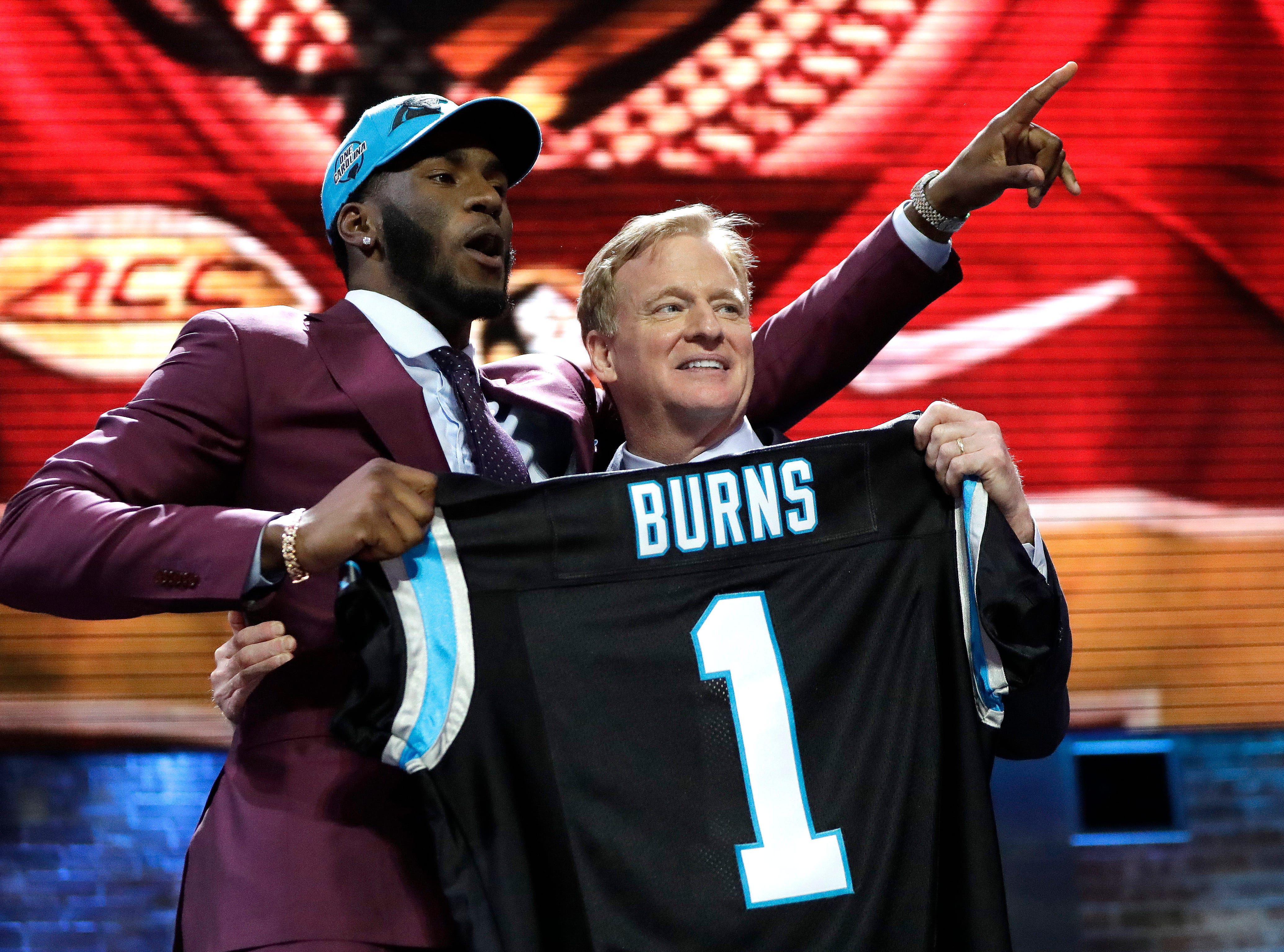 Florida State defensive end Brian Burns poses with NFL Commissioner Roger Goodell after the Carolina Panthers selected Burns in the first round at No. 16 at the NFL football draft, Thursday, April 25, 2019, in Nashville, Tenn. (AP Photo/Mark Humphrey)