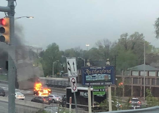 A car caught fire on Route 3 in Rutherford April 26, 2019.