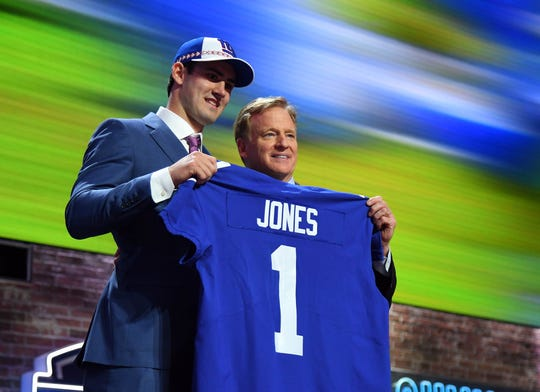 Apr 25, 2019; Nashville, TN, USA; Daniel Jones (Duke) stands with NFL commissioner Roger Goodell after he was selected as the number six overall pick to the New York Giants in the first round of the 2019 NFL Draft in Downtown Nashville. Mandatory Credit: Christopher Hanewinckel-USA TODAY Sports