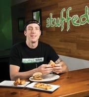 Dan Campeas, owner of Stuffed Burgers in Montclair, gets ready to sample his menu.  ANNE-MARIE CARUSO
