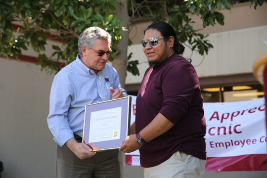 "New Mexico State University President John D. Floros presented Michael Ray, director of NMSU's American Indian Programs, with the ""A"" Mountain staff award during Founders Day April 26, 2019."
