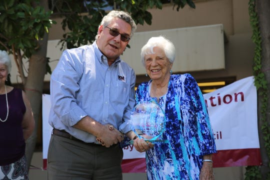 Barbara Hubbard was honored as an Aggie Legend during Founders Day at New Mexico State University April 26, 2019. She stands with NMSU President John Floros.