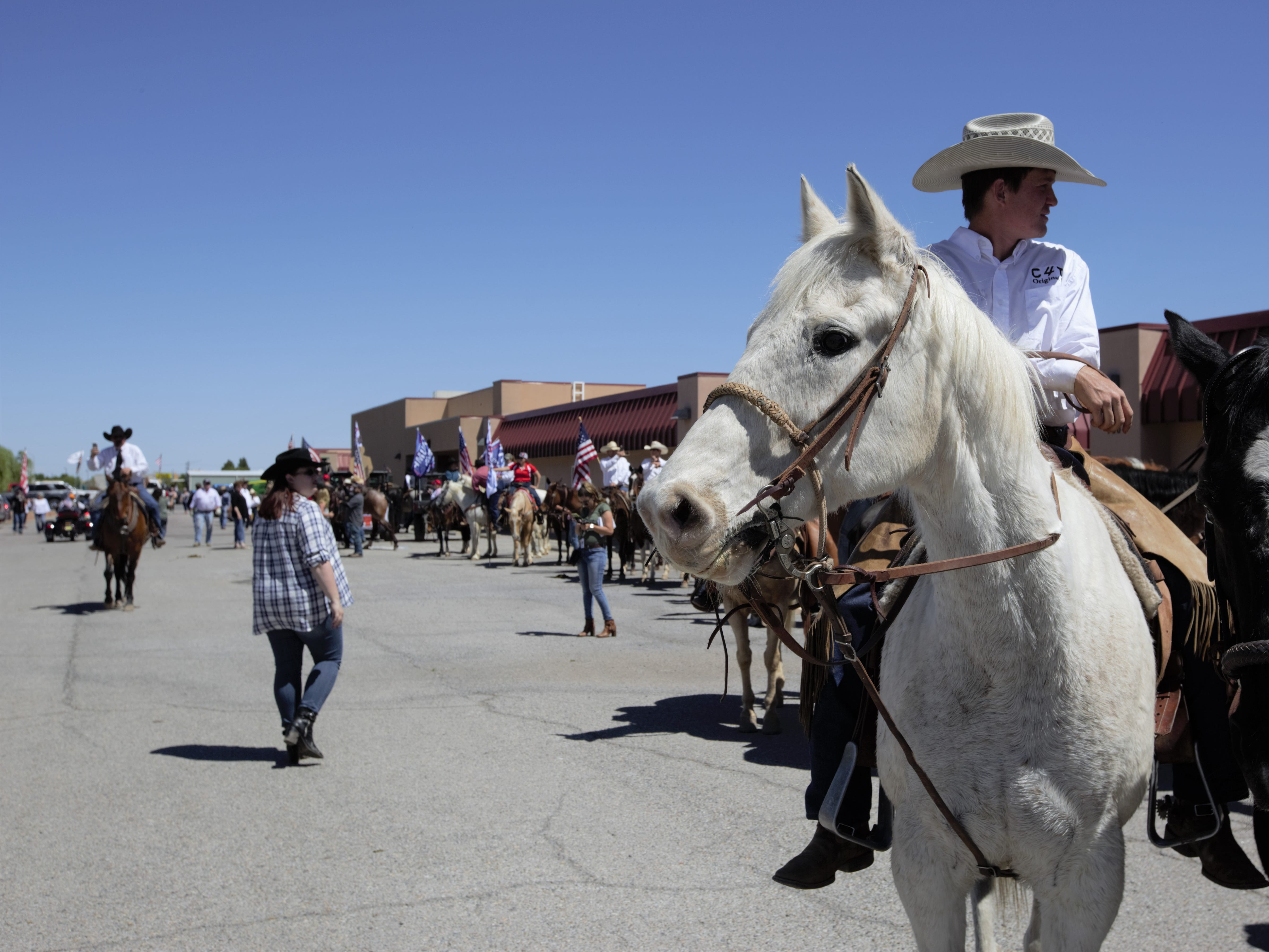 Many participants in a Cowboys for Trump event in Las Cruces on Thursday, April 25, 2019 rode horseback and stayed seated on horses throughout the rally.