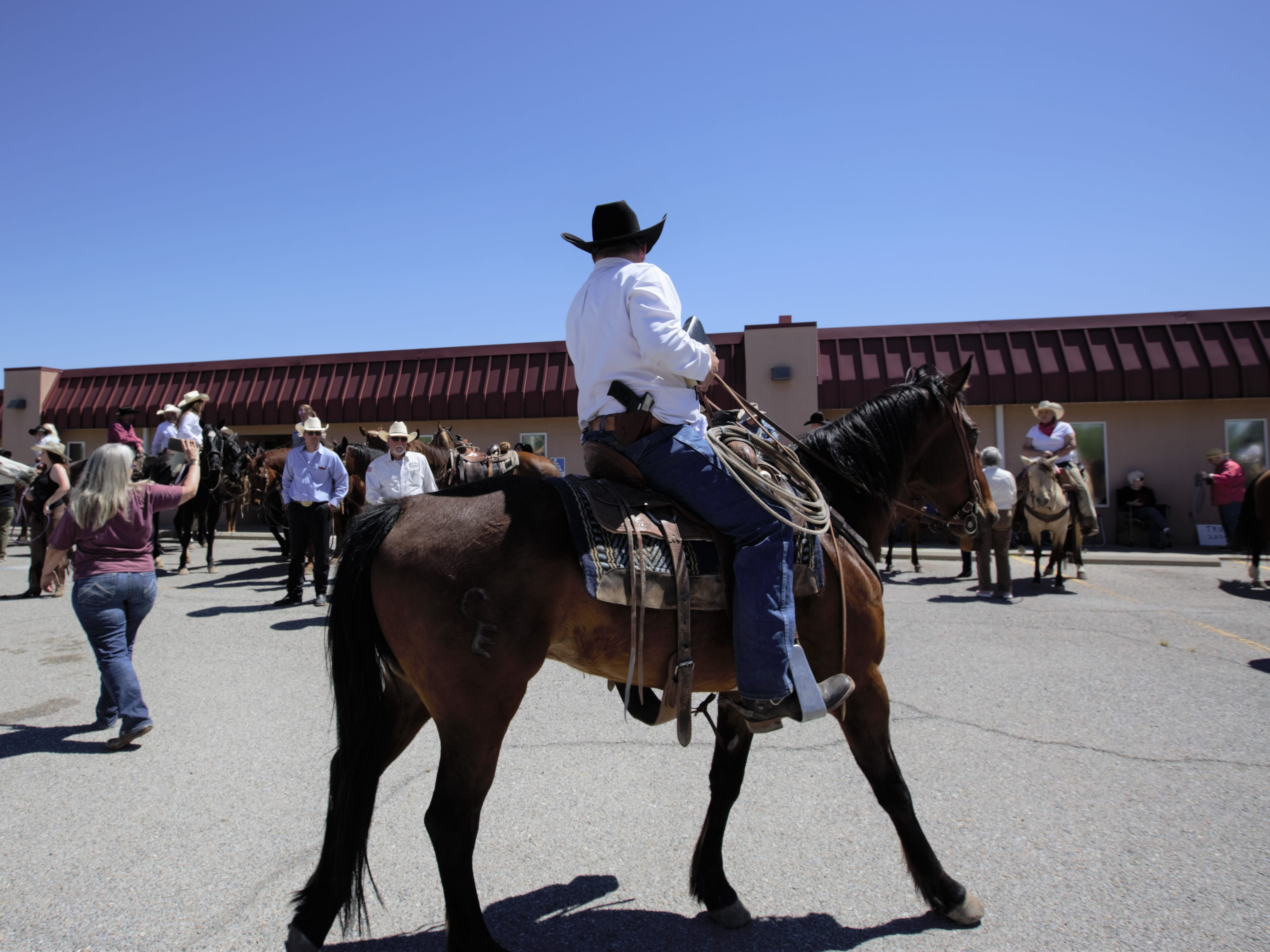 Several participants in a Cowboys for Trump ride and rally on Thursday, April 25, 2019 openly carried firearms. Several attendees said they were there to oppose gun restrictions, among other issues.