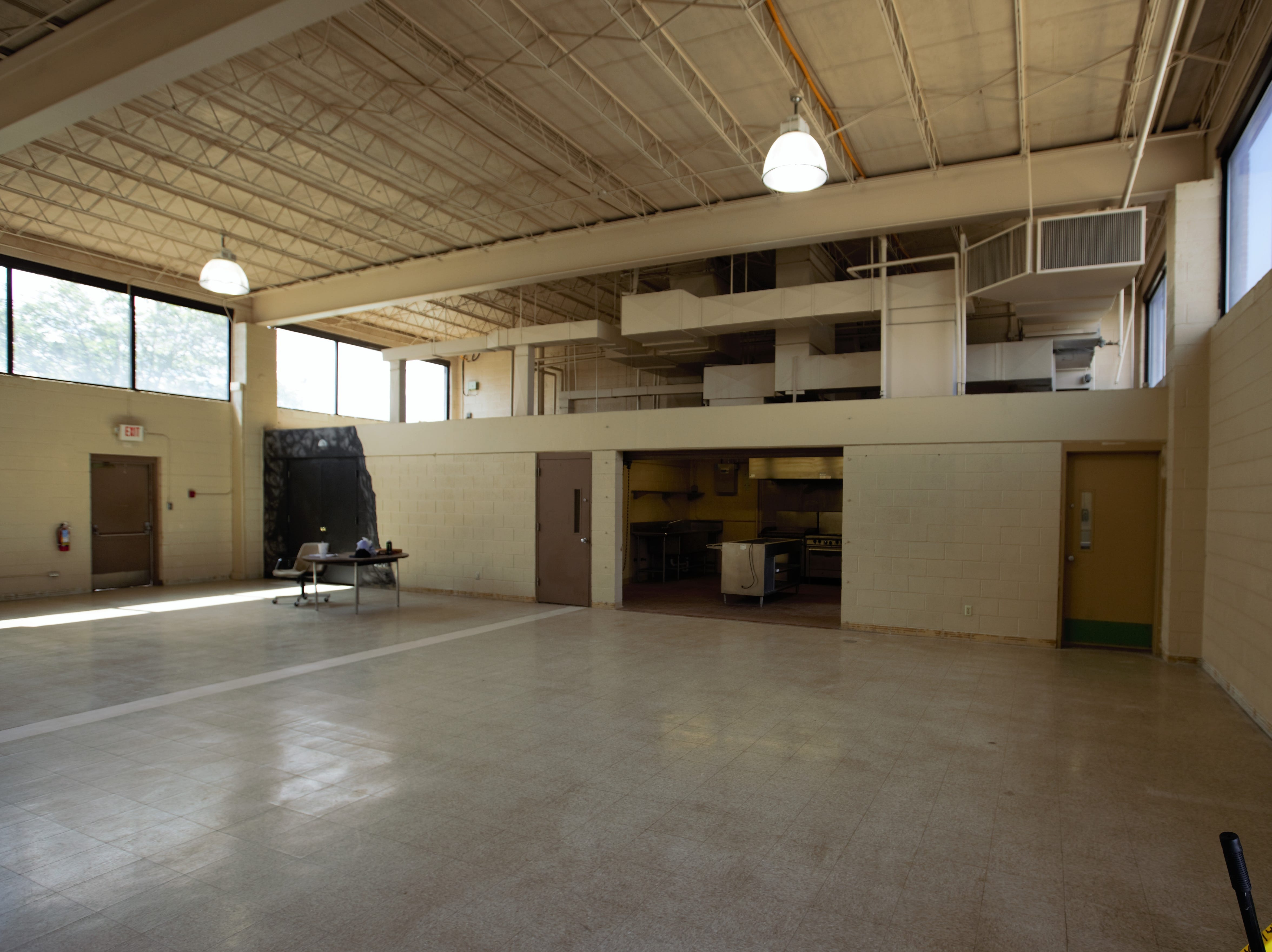 Dining area with adjacent kitchen to provide meals for asylum applicants at the former U.S. Army Reserve Center at 1300 W. Brown Road in Las Cruces. Friday, April 26, 2019.