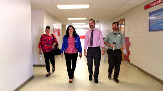 Maria Zuniga, programs manager for Children's Reading Alliance, left; New Mexico Public Education Secretary Karen Trujillo; David Greenberg, Las Cruces Public Schools coordinator for community schools; and Patrick DeSimio, Board Treasurer & Chief Strategy Officer of Cruces Creatives walk the halls of Lynn Community Middle School during a tour on Tuesday, April 23, 2019.
