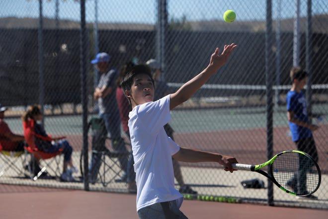 Farmington's Ethan Nguyen serves the ball against Piedra Vista during Thursday's District 2-5A duals at Farmington Sports Complex.