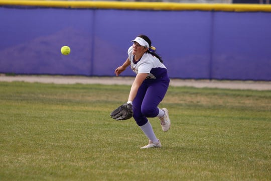 Kirtland Central's Addisyn Sanchez looks to make a catch in right field against Aztec during Friday's District 1-4A game at KCHS.