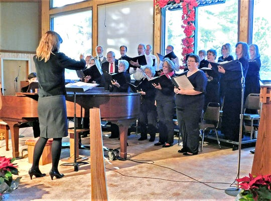 Melba Valdez, ENMU-Ruidoso Community Choir director, guides singers at last year's Christmas concert.