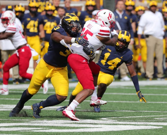 Sep 22, 2018; Ann Arbor, MI, USA; Michigan defenders Rashan Gary, left, and Josh Metellus tackle Nebraska running back Greg Bell during the first half at Michigan Stadium. Mandatory Credit: Kirthmon F. Dozier/Detroit Free Press via USA TODAY Sports