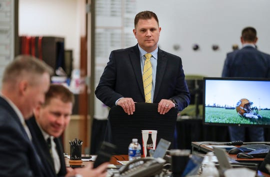 Green Bay Packers general manager Brian Gutekunst oversees the team's draft room Thursday night at Lambeau Field in Green Bay.
