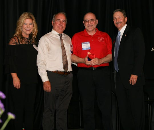 From left: Mistress of ceremonies Heather Froglear; Clinical Operations Director Dr. Brian Hodgkins; Desert Oasis Healthcare Medical Director Dr. Marc Hoffing, holding LifeStream's 2019 Award for Medical Excellence; and LifeStream President and CEO and Medical Director Dr. Fredrick Axelrod.