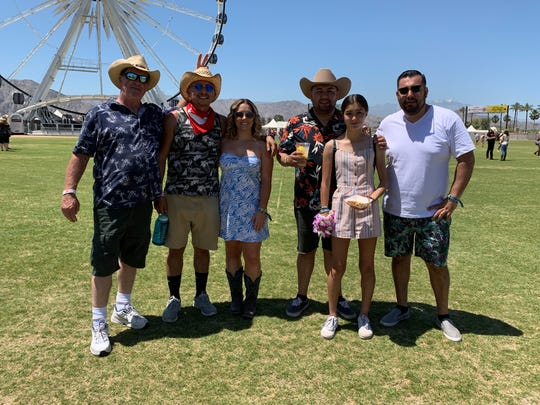 Attendees don their Hawaiian wear on Aloha Friday during the Stagecoach country music festival in Indio, Calif. on April 26, 2019.
