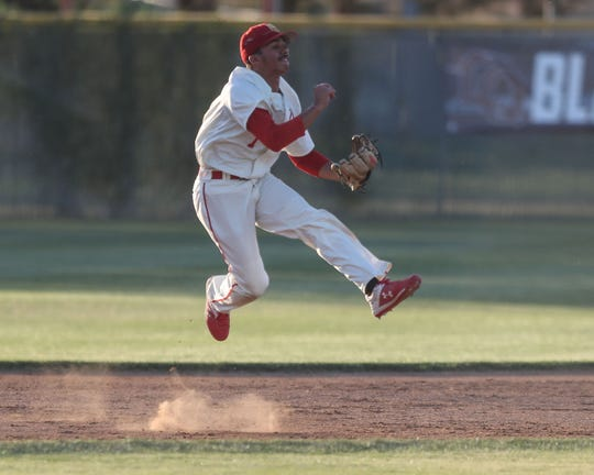 Jordan Sprinkle makes a play on defense for Palm Desert during the Desert Empire League baseball championship at La Quinta High School, April 25, 2019.