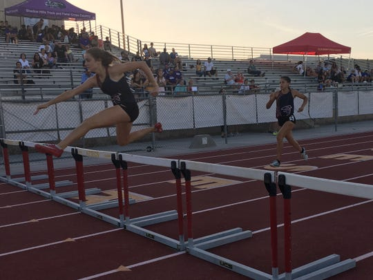 Isabella Fakehany of La Quinta leaps a hurdle on the way to winning the 300-meter hurdle race Thursday during the DEL meet.