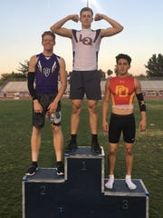 La Quinta's Parker Williams stands atop the podium after his win in the 110-meter hurdles.