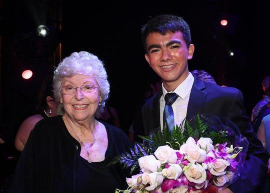 Emerald Circle sponsor Connie Tirschwell with Grand Prize Award and Audience Favorite Award Winner Saigo Iniguez