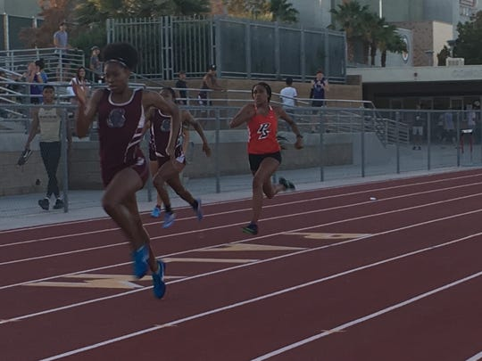 Trinity Barnett of Rancho Mirage runs away from the crowd to win the 200-meter race Thursday at the Desert Empire League meet.