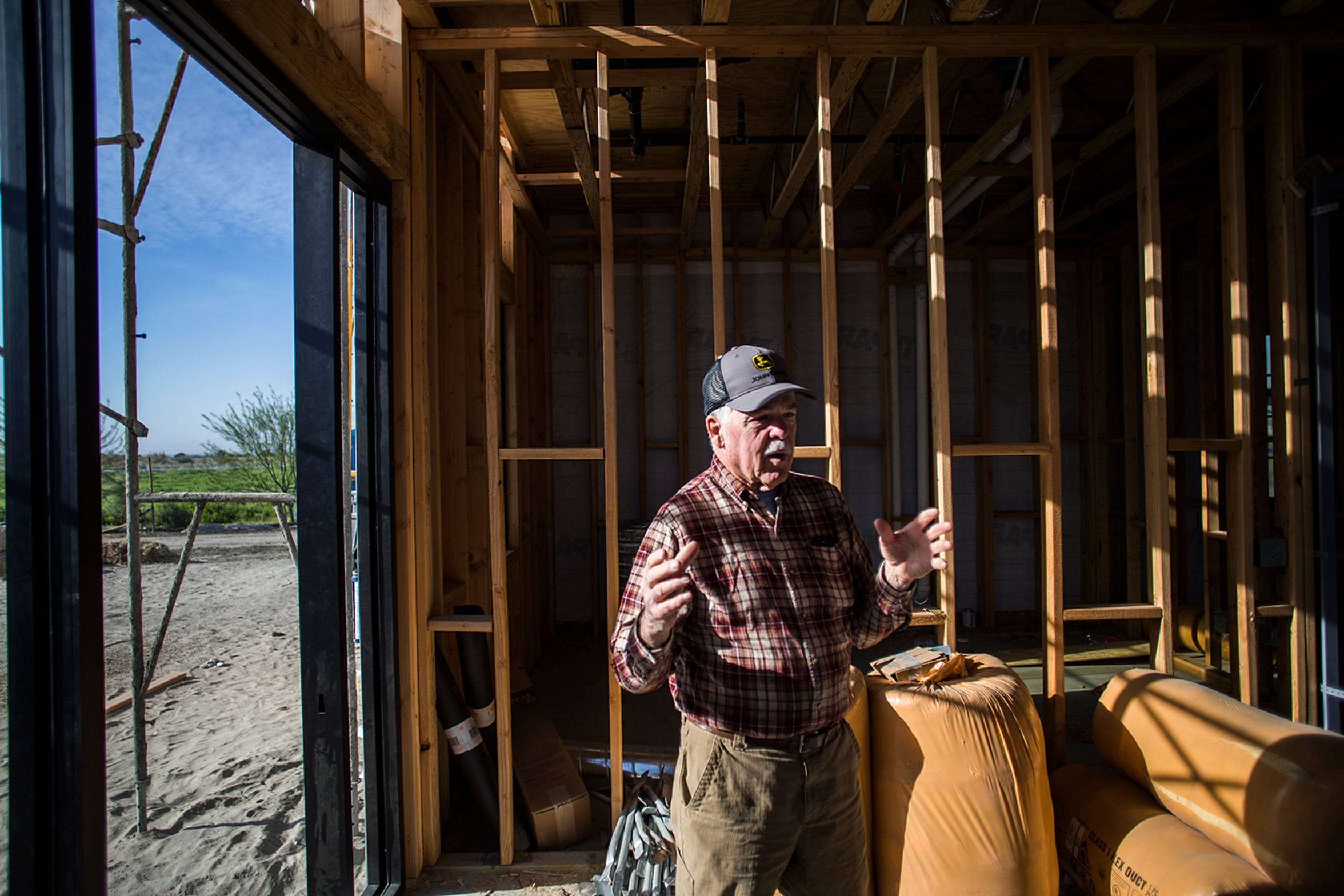 Paul Turner, 73, an economic consultant who has worked for the tribe since the late 1990s stands inside the the structure that will house the tribe's organic farmers market.