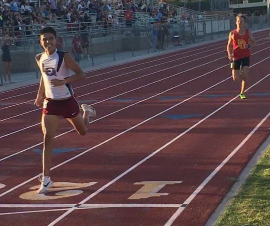 Raen Reyes of La Quinta legs out a victory in the 1,600-meter race Thursday at the DEL meet.