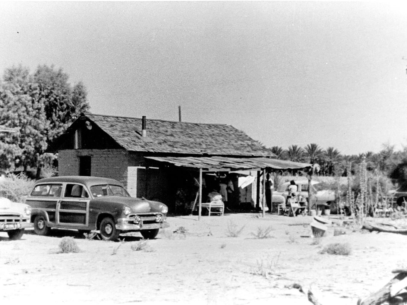 A historical photo shows the home of Julian Augustine, one of Captain Vee-Vee Augustine's five children.